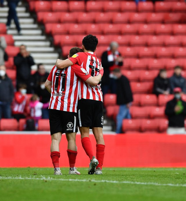 Lynden Gooch and Luke O'Nien at the end of the Lincoln City play-off game.