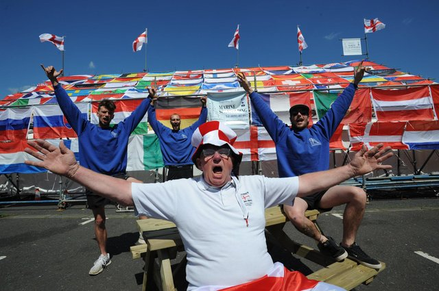 Norman Scott of Dougie's Tavern has prepared for the Euros with help from (from left) JJ Mullen, Tom Mullen and Chris White of Marine Scaffolding. JPI image.