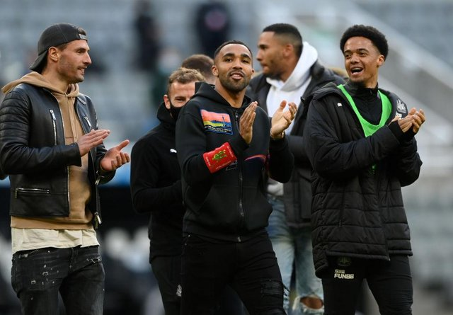Fabian Schar, Callum Wilson and Jamal Lewis of Newcastle United applaud the fans after the Premier League match between Newcastle United and Sheffield United at St. James Park on May 19, 2021 in Newcastle upon Tyne, England.