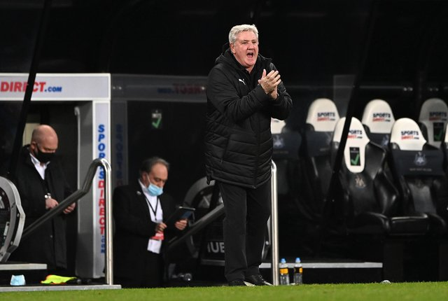 Newcastle United manager Steve Bruce applauds his team on the sideline during the Premier League match between Newcastle United and Wolverhampton Wanderers at St. James Park on February 27, 2021.