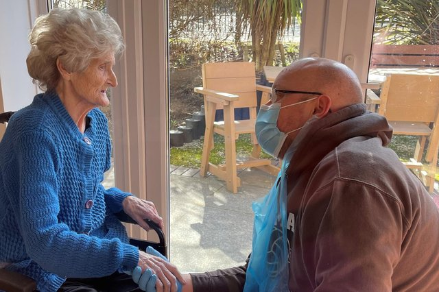 Palmersdene care home resident Mary Pinder was able to see her son John Pinder and hold his hand for the first time as restictions were eased.