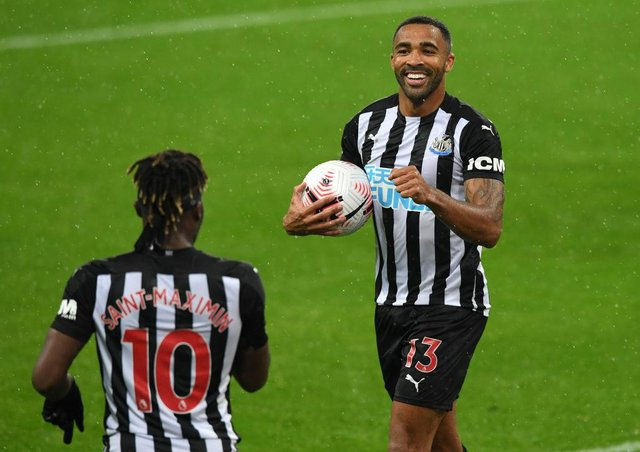 Callum Wilson of Newcastle United celebrates with teammate Allan Saint-Maximin (Photo by Stu Forster/Getty Images)
