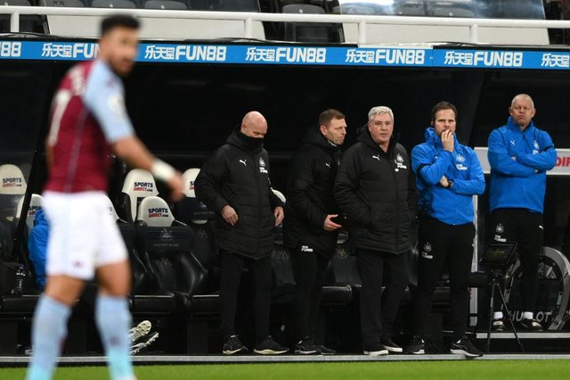 Newcastle manager Steve Bruce (c) and his coaches react during the Premier League match between Newcastle United and Aston Villa at St. James Park on March 12, 2021 in Newcastle upon Tyne, England.