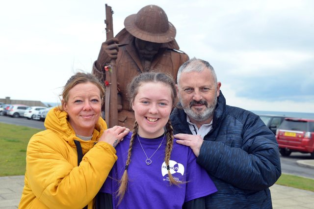 Kayleigh Llewellyn, 13, who underwent a heart transplant, with parents Shaun and Sonia Llewellyn. Kayleigh will take part in a charity walk from South Shields to Seaham in memory of her donor.