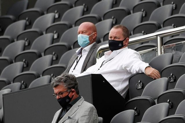 Newcastle United's English owner Mike Ashley (R) watches the English Premier League football match between Newcastle United and Brighton and Hove Albion at St James' Park in Newcastle upon Tyne, north-east England on September 20, 2020.