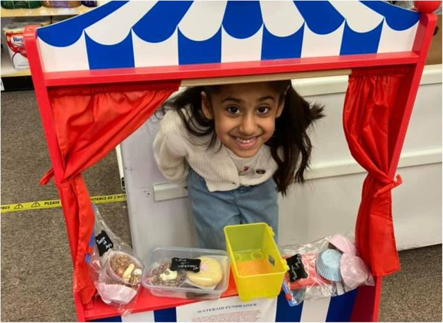 Anjali sold cakes at her family's post office to raise money for WaterAid.