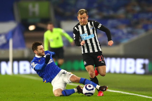 Newcastle United's Ryan Fraser (right) and Brighton and Hove Albion's Adam Lallana battle for the ball during the Premier League match at the AMEX Stadium, Brighton. Picture date: Saturday March 20, 2021.