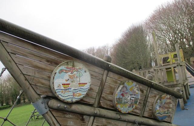 The damaged mosaic shields at Charlie's Park, Jarrow.