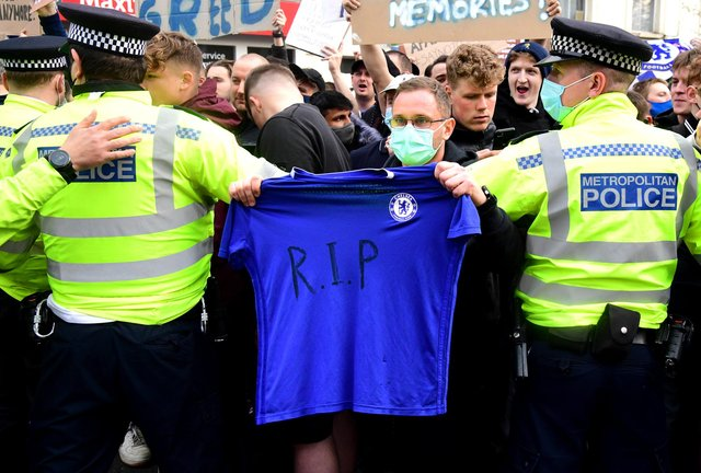 Chelsea fans protest outside Stamford Bridge.
