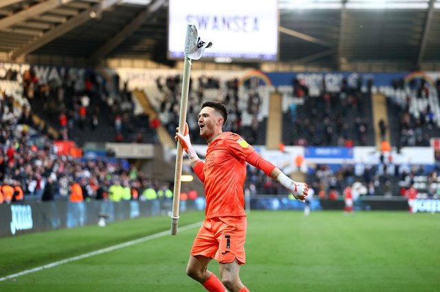 Freddie Woodman of Swansea City celebrates at full time following the Sky Bet Championship Play-off semi-final second leg match between Swansea City and Barnsley at Liberty Stadium.