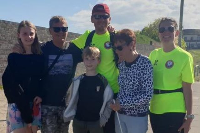 Chris and his family, including mum Joan and wife Joanna