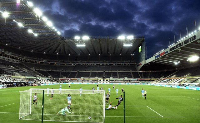 Newcastle player Joe Willock scores the third Newcastle goal after having his penalty saved by Scott Carson during the Premier League match between Newcastle United and Manchester City at St. James Park on May 14, 2021 in Newcastle upon Tyne, England.