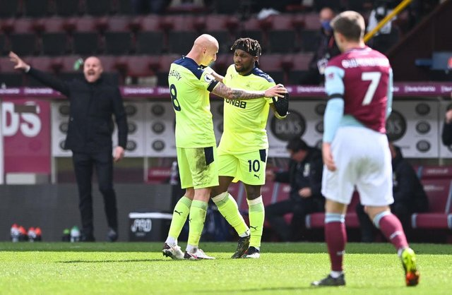 Allan Saint-Maximin of Newcastle United celebrates with Jonjo Shelvey after scoring their side's second goal during the Premier League match between Burnley and Newcastle United at Turf Moor on April 11, 2021 in Burnley, England.