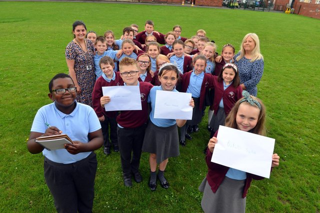 St Bede's Primary School children have sent personal letters to England player Marcus Rashford, Bukayo Saka and Jadon Sancho following racist abuse after the Euro 2020 final defeat. From left Ivan Murwisi, nine, Joshua Rixom, nine, Jessica Roberts, nine and Lainey Bradley, nine with teacher Jessica Romano and teaching assistant Sharon Hunt.