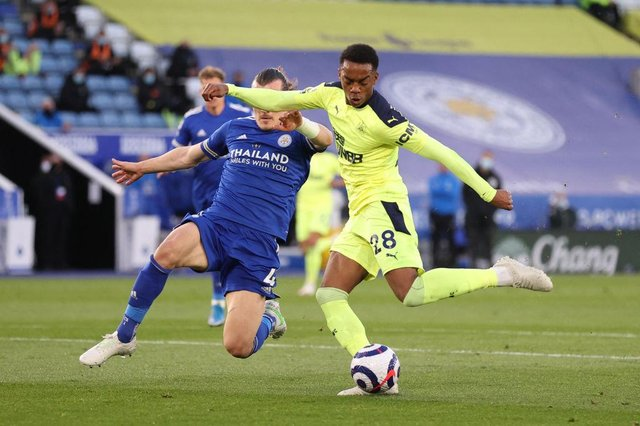 Newcastle United's English midfielder Joe Willock (R) shoots and scores their first goal during the English Premier League football match between Leicester City and Newcastle United at King Power Stadium in Leicester, central England on May 7, 2021.
