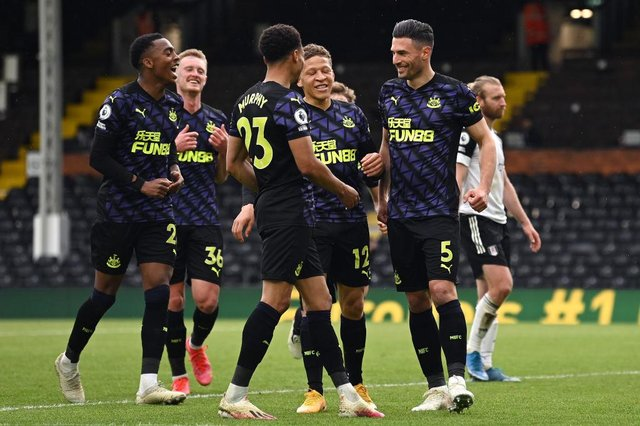 Fabian Schar of Newcastle United celebrates with team mates Dwight Gayle, Joe Willock and Jacob Murphy after scoring his team's second goal during the Premier League match between Fulham and Newcastle United at Craven Cottage on May 23, 2021 in London, England.