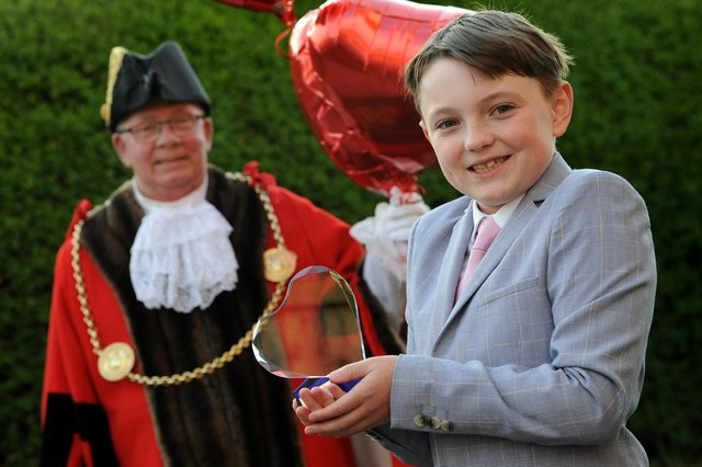 #LoveSouthTyneside winner 9-year-old Oliver Nicholson receives his award from the Mayor Cllr Norman Dick and Mayoress Mrs Jean Williamson.