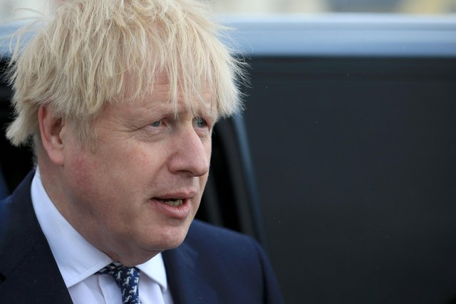 Boris Johnson reacts as he greets members of the public while campaigning on behalf of Conservative Party candidate Jill Mortimer (unseen) ahead of the 2021 Hartlepool by-election to be held on May 6 on May 3, 2021 in Hartlepool, north-east England. (Photo by Lindsey Parnaby - WPA Pool/Getty Images)