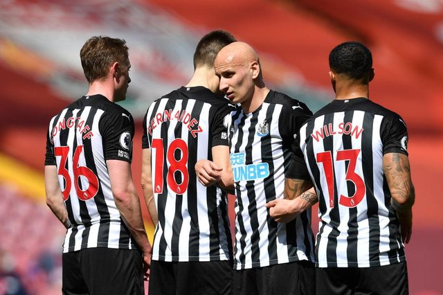 Sean Longstaff, Federico Fernandez, Jonjo Shelvey and Callum Wilson of Newcastle United line up in the wall for a free kick during the Premier League match between Liverpool and Newcastle United at Anfield on April 24, 2021 in Liverpool, England.