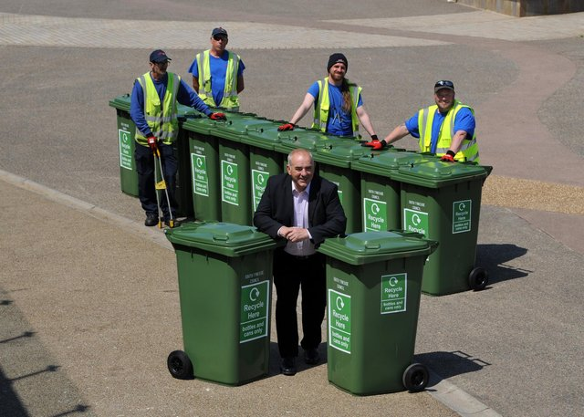 South Tyneside Council Cllr Ernest Gibson, with season beach workers, John Hunter, Rya MacAtee, Ian Winter and Danny George, with new waste recycling bins along the walkway, Sandhaven Beach, South Shields.