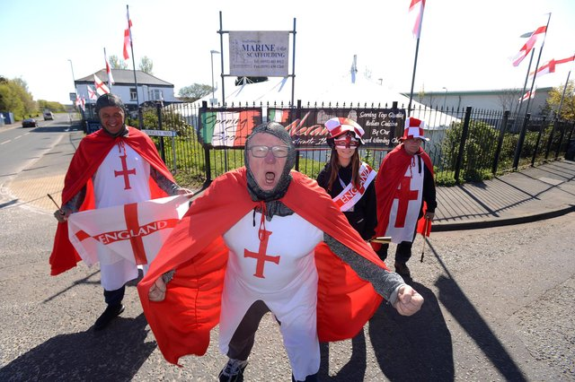 Dougie's Tavern manager Norman Scott dressed up for St George's Day. (Back from left) Gary Ablett, Natasha Jowsey and Bobby Park.