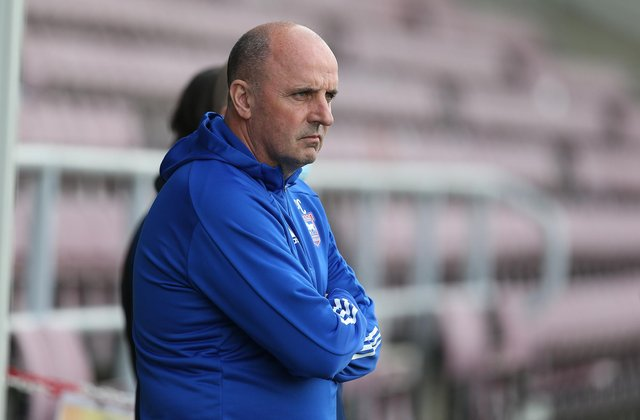 Ipswich Town manager Paul Cook looks on prior to the Sky Bet League One match between Northampton Town and Ipswich Town.