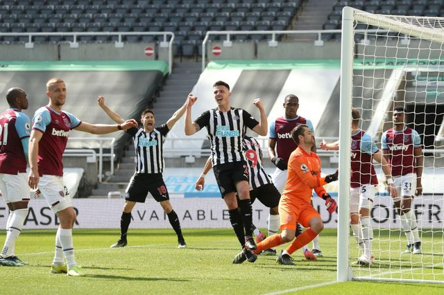 Ciaran Clark of Newcastle United celebrates after his teammate Joelinton scored their side's second goal during the Premier League match between Newcastle United and West Ham United at St. James Park on April 17, 2021 in Newcastle upon Tyne, England.