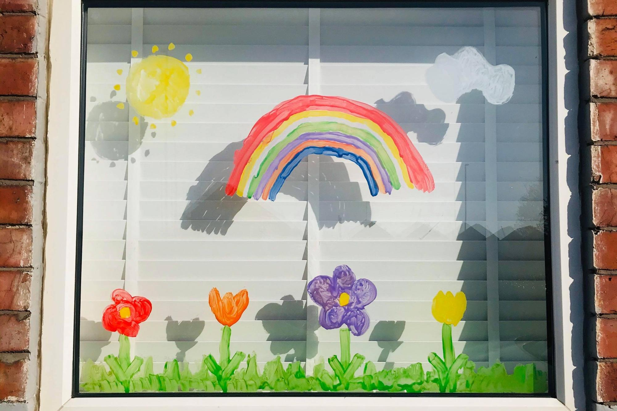why rainbows are appearing in the windows of homes around