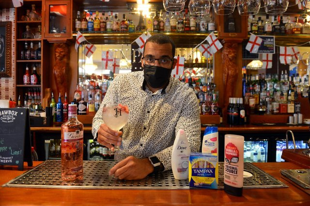 Manager Alex Ozobia at Hogarths, which is running a donation drop for a food bank, with kind-hearted customers taking part to receive a free gin and tonic for World Gin Day.