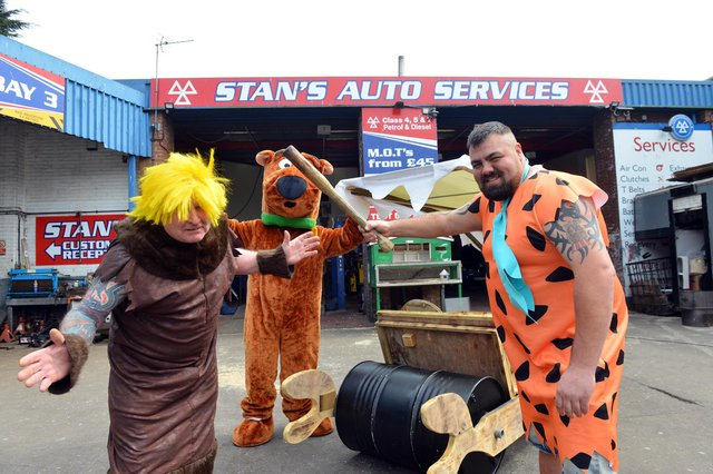 A Flintstones car made to cheer people up during the pandemic. Stan Yanetta as Barney Rubble, Gary Thorius as Fred Flintstone and Simon Lishman as 'Dino'.