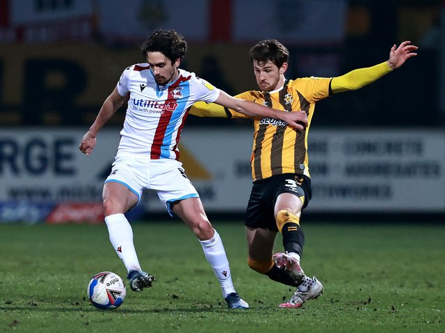 Alex Gilliead of Scunthorpe United is challenged by Jack Iredale during the Sky Bet League Two match between Cambridge United and Scunthorpe United