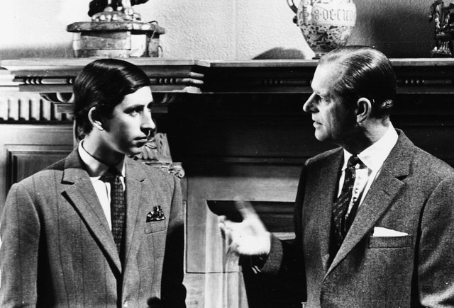 Prince Charles talking to his father, the Duke of Edinburgh, in front of a fireplace at Sandringham, Scotland, 1969. Picture: Central Press/Hulton Archive/Getty Images.
