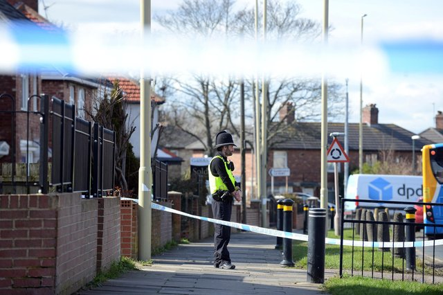 Police at the scene in Prince Edward Road on March 15.