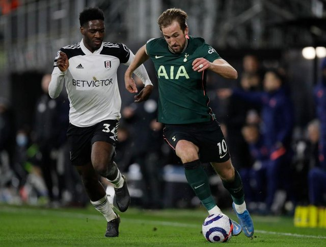 Harry Kane of Tottenham Hotspur is challenged by Ola Aina of Fulham during the Premier League match between Fulham and Tottenham Hotspur.